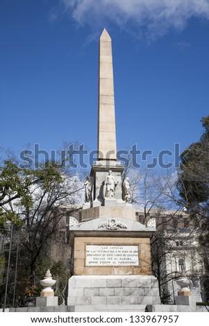 Madrid - monumento Dos de Mayo from Plaza la Lealtad - stock photo