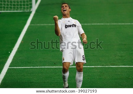 MADRID - SEPT 30: Cristiano Ronaldo celebrates the third goal of Real Madrid's 3-0 victory over Olympique Marseille in Champions League group stage action September 30, 2009 in Madrid. - stock photo