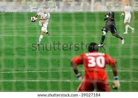 MADRID - SEPT 30: Cristiano Ronaldo shoots on goal during the first half of Real Madrid's 3-0 victory over Olympique Marseille in Champions League group stage action September 30, 2009 in Madrid. - stock photo