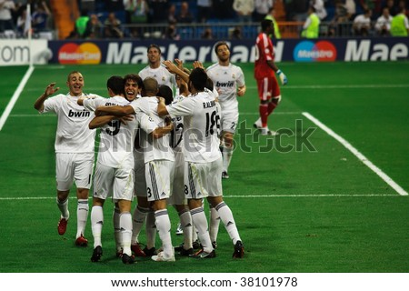 MADRID- SEPT 30: Real Madrid players celebrate Cristiano Ronaldo's third goal during Real Madrid's 3-0 win over Olympique Marseille in Champions League group stage action September 30, 2009 in Madrid - stock photo