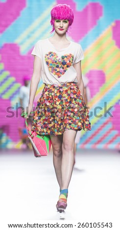 MADRID - SEPTEMBER 13: a model walks on the Agatha Ruiz de la Prada catwalk during the Mercedes-Benz Fashion Week Madrid Spring/Summer 2015 runway on September 13, 2014 in Madrid.  - stock photo