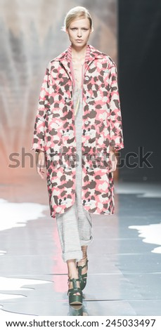 MADRID - SEPTEMBER 13: a model walks on the Ailanto catwalk during the Mercedes-Benz Fashion Week Madrid Spring/Summer 2015 runway on September 13, 2014 in Madrid.  - stock photo