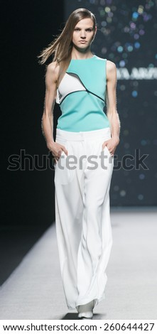 MADRID - SEPTEMBER 14: a model walks on the Amaya Arzuaga catwalk during the Mercedes-Benz Fashion Week Madrid Spring/Summer 2015 runway on September 14, 2014 in Madrid.  - stock photo