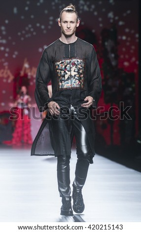 MADRID - SEPTEMBER 18: a model walks on the Francis Montesinos catwalk during the Mercedes-Benz Fashion Week Madrid Spring/Summer 2015 runway on September 18, 2015 in Madrid.  - stock photo