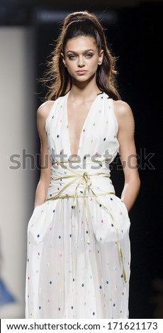 MADRID - SEPTEMBER 14: A model walks on the Miguel Palacio catwalk during the Cibeles Madrid Fashion Week runway on September 14, 2013 in Madrid.  - stock photo