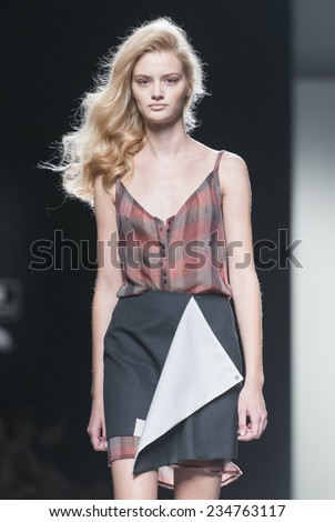 MADRID - SEPTEMBER 14: a model walks on the Rabaneda catwalk during the Mercedes-Benz Fashion Week Madrid Spring/Summer 2015 runway on September 14, 2014 in Madrid.  - stock photo