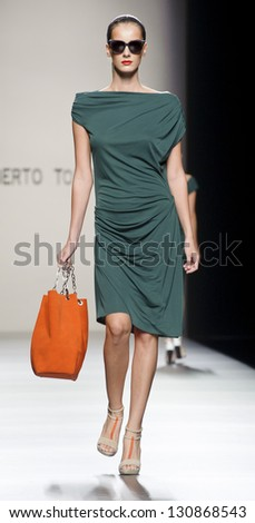 MADRID � SEPTEMBER 02: A model walks on the Roberto Torretta catwalk during the Cibeles Madrid Fashion Week runway on September 02, 2012 in Madrid. - stock photo