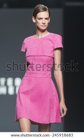 MADRID - SEPTEMBER 13: a model walks on the Teresa Helbig catwalk during the Mercedes-Benz Fashion Week Madrid Spring/Summer 2015 runway on September 13, 2014 in Madrid.  - stock photo
