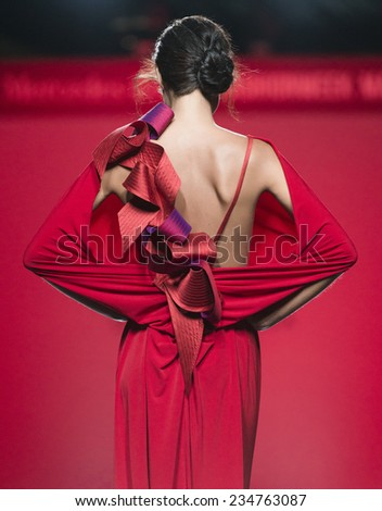 MADRID - SEPTEMBER 14: a model walks on the Ulises Merida catwalk during the Mercedes-Benz Fashion Week Madrid Spring/Summer 2015 runway on September 14, 2014 in Madrid.  - stock photo