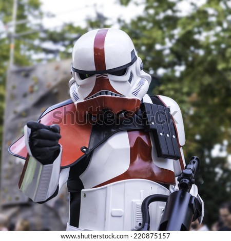 MADRID - SEPTEMBER 20: A stormtrooper points his finger at the audience during the Training Day VI parade - 501st Spanish Garrison in Madrid, on September 20, 2014 - stock photo