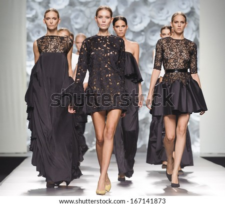 MADRID - SEPTEMBER 15: Models walking on the Juana Martin catwalk during the Cibeles Madrid Fashion Week runway on September 15, 2013 in Madrid.  - stock photo