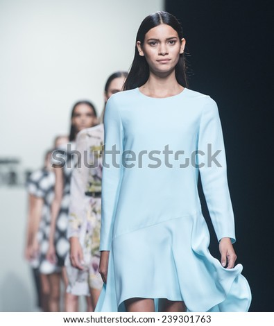 MADRID - SEPTEMBER 13: models walking on the Roberto Torretta catwalk during the Mercedes-Benz Fashion Week Madrid Spring/Summer 2015 runway on September 13, 2014 in Madrid.  - stock photo