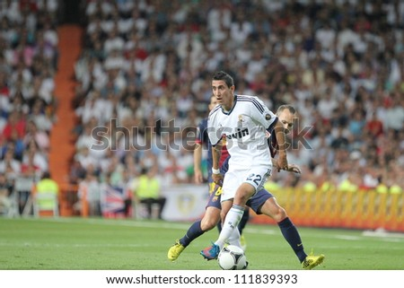 MADRID, SPAIN - AUGUST 29: Angel Di Maria running with the ball during the Supercopa, Real Madrid vs FC Barcelona, on August 29, 2012 at the Santiago Bernabeu Stadium. - stock photo