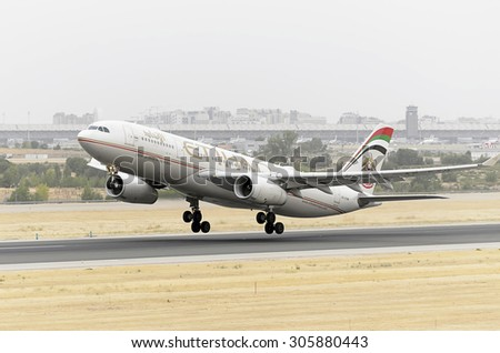 MADRID, SPAIN - AUGUST 8th 2015: Aircraft -Airbus A330-243-, of -Etihad Airways- airline, is taking off from Madrid-Barajas -Adolfo Suarez- airport, on August 8th 2015. - stock photo