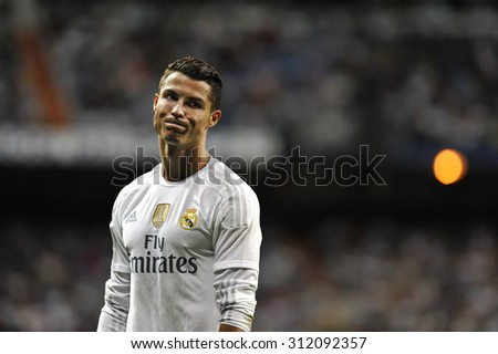 MADRID, SPAIN - August 29th, 2015 : Portuguese CRISTIANO RONALDO of Real Madrid dejected after missing a goal during  La Liga match vs Betis at Santiago Bernabeu Stadium - stock photo