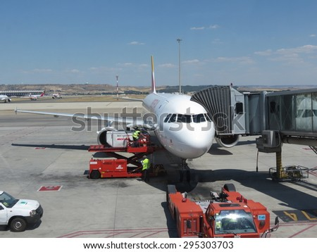 MADRID, SPAIN - CIRCA JUNE 2015: aircraft parked at the airport - stock photo