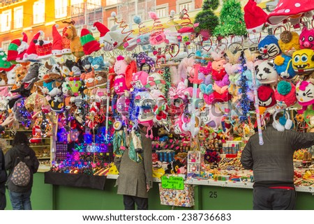 MADRID,SPAIN - DECEMBER 18: Famous Christmas market full of shops with all kinds of articles for parties and some street performers in December 18, 2014 , Madrid Spain - stock photo