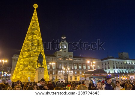 MADRID,SPAIN - DECEMBER 18: The famous Puerta del Sol crowded shopping for christmas December 18, 2014 in Madrid Spain - stock photo