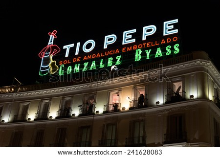 MADRID, SPAIN - DECEMBER 31, 2014: The Tio Pepe sign at Puerta del Sol in Madrid on December 31 in Madrid. Cameras situated on the balconies are set up to film New Year celebrations on Puerta del Sol. - stock photo