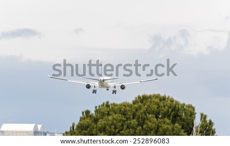 MADRID, SPAIN - FEBRUARY 14th 2015: Airplane -Airbus A330-200-, of -Air Europa- airline, landing on Madrid-Barajas airport, on February 14th 2015. - stock photo