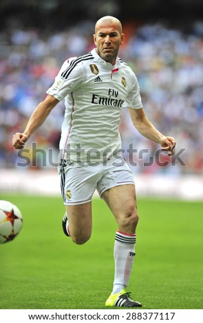 MADRID, SPAIN - June 14th, 2015 : ZINEDINE ZIDANE former legendary player of Real Madrid in action during Real Madrid vs Liverpool Legends friendly match at Santiago Bernabeu Stadium - stock photo