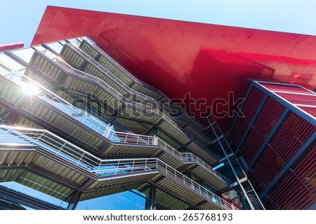 MADRID, SPAIN - MARCH16,2015: modern facade of the Museo Nacional Centro de Arte Reina Sofia, Spains national museum of 20th-century art. It was officially inaugurated 1992 and named for Queen Sofia - stock photo