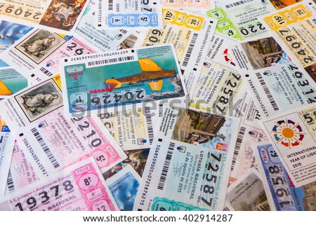 MADRID, SPAIN - MARCH 29, 2016: Spanish national lottery receipts. National lottery is known in Spain as Loteria Nacional and is promoted for loterias y apuestas del estado - stock photo
