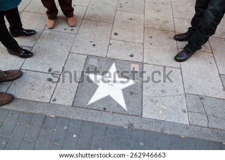 MADRID, SPAIN - MARCH 16, 2015: star of the Walk of Fame in Madrid, a section of a street in which honors the most outstanding actors of Spanish cinema, equivalent to the Walk of Fame in Hollywood. - stock photo