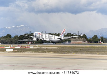MADRID, SPAIN - MARCH 05th 2016: Jumbo jet airliner -Airbus A330-, of -Air Europa- airline, is landing in Madrid Barajas airport (Spain), on March 05th 2016. - stock photo