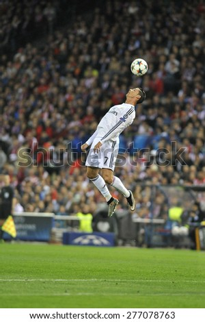 MADRID, SPAIN - March 10th, 2015 :  Portuguese CRISTIANO RONALDO of REAL MADRID jumping for head kick during Europe Champions League match at Santiago Bernabeu Stadium - stock photo