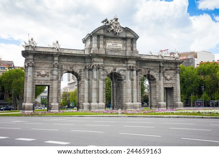 Madrid, Spain - May 6, 2012: Alcal Gate (Puerta de Alcala) a monument in the Independence Square (Plaza de la Independencia) in Madrid, Spain. - stock photo