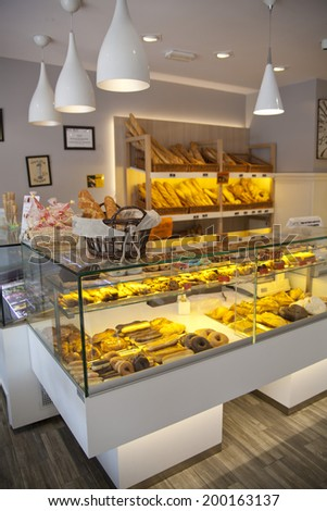 MADRID, SPAIN - MAY 28, 2014: Local coffee shop and variety of baked products - stock photo