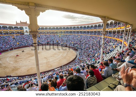 Madrid, Spain - May 11, 2012: Plaza de Toros de Las Ventas interior view with tourists gathered for the bull show in Madrid on a sunny day, Spain - stock photo