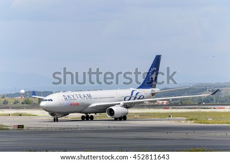 MADRID, SPAIN - MAY 15th 2016: Aircraft -Airbus A330- of -Air Europa- operator, direction to airport terminal of Madrid-Barajas airport, after it has landed, on May 15th 2016. SkyTeam livery. - stock photo