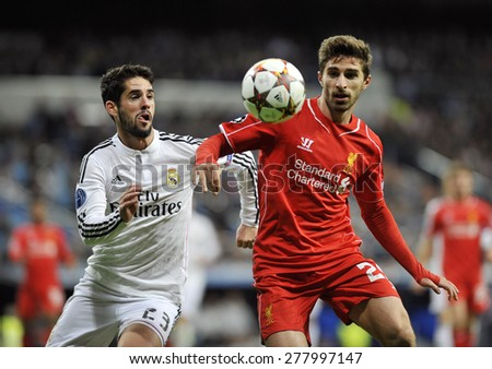 MADRID, SPAIN - November 11th, 2014 :  ISCO  of REAL MADRID in action vs FABIO BORINI of LIVERPOOL during the UEFA Champions League match at Santiago Bernabeu Stadium  - stock photo