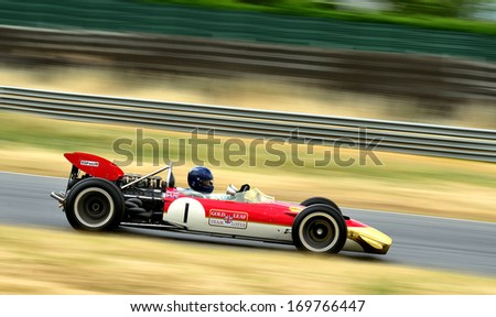 MADRID, SPAIN - OCT 30 : A driver races in a classic Graham Hill's Lotus 49B during the Jarama Vintage Festival, on Oct 30, 2011 in Madrid, Spain. - stock photo