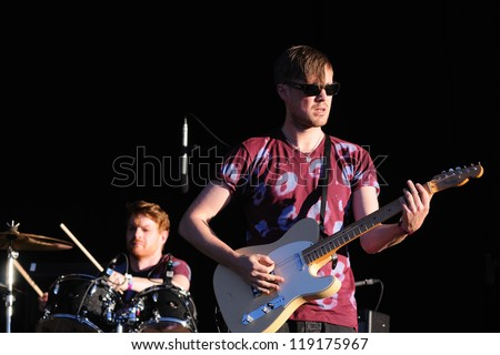 MADRID, SPAIN - SEPT 15: Django Django band performs at Dcode Festival on September 15, 2012 in Madrid. David Maclean (drummer and producer) and Vincent Neff (singer and guitarist). - stock photo