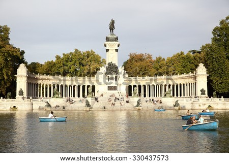 MADRID, SPAIN - SEPTEMBER 23, 2015: Pond and Monument to Alfonso XII in the Parque del Buen Retiro in Madrid - stock photo