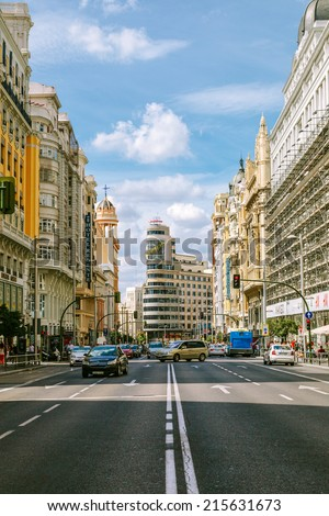 MADRID, SPAIN - SEPTEMBER 7: View Gran Via with the Capitol Building, one of the main streets and most famous landmarks of the city, on September 7, 2014 in Madrid, Spain - stock photo
