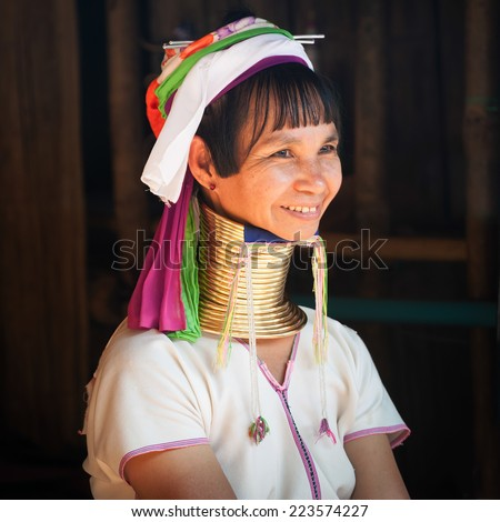 MAE HONG SON, THAILAND - DEC 4, 2013: Unidentified Karen (Kayan Lahwi Padaung) Long Neck woman with traditional brass coils and clothes in tribe village. Chang Rai province, Thailand  - stock photo