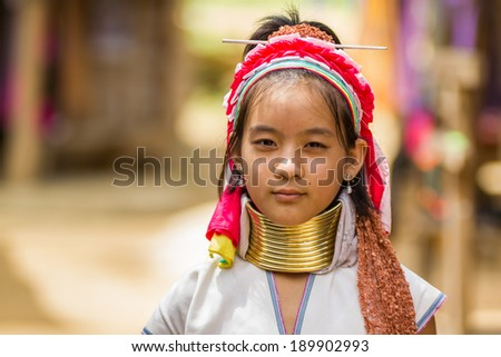 Mae Hong Son, Thailand - July 22 2013: Karen tribe girl poses for the camera in Mae Hong Son. The Karen people wear brass rings around their neck from as young as five years old. - stock photo