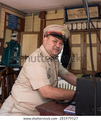 MAE TAN NOI, THAILAND - MARCH 22 2015: Officers continue to work at remote train station Mae Tan Noi on one of the hottest recorded days in Northern Thailand. - stock photo