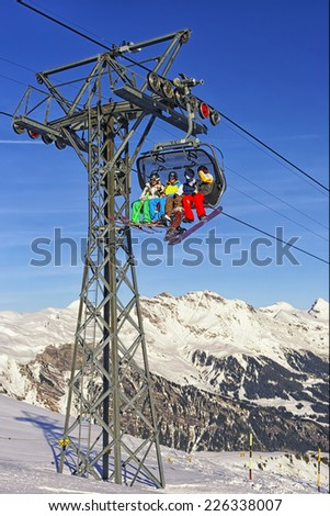 MAENNLICHEN, SWITZERLAND - DECEMBER 31, People on ski and snowboards at cable car cabin on winter sport resort in swiss alps on December 31, 2013 in swiss Jungfrau region - stock photo