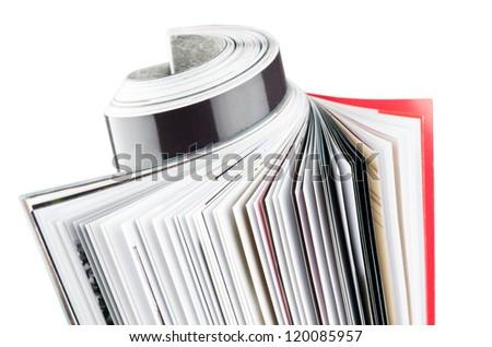 Magazine rolled up  on white background - stock photo