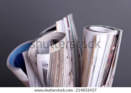 Magazines on gray background - stock photo