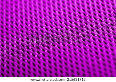 magenta background. Mesh fabric texture. Macro perspective - stock photo
