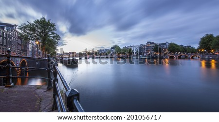 Magere Brug (Skinny bridge) on the Amstel River, Amsterdam, the Netherlands - stock photo