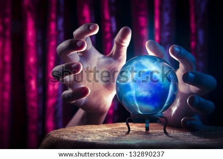 Magic crystal ball on a table - stock photo