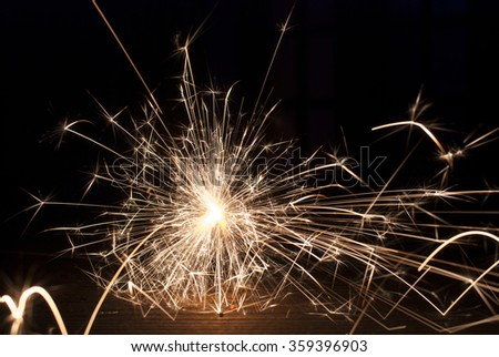 Magic glowing Flow of Sparks in the Dark. Sparks - stock photo