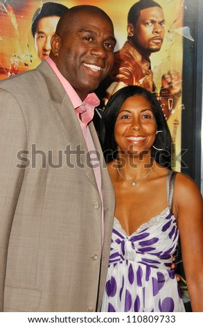 "Magic Johnson and Cookie Johnson at the Los Angeles Premiere of ""Rush Hour 3"". Mann's Chinese Theater, Hollywood, CA. 07-30-07 - stock photo"
